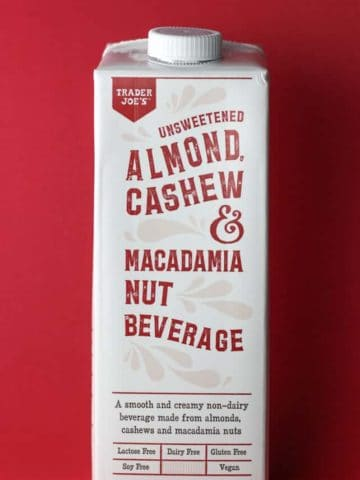 An unopened package of Trader Joe's Unsweetened Almond Cashew and Macadamia Nut Beverage