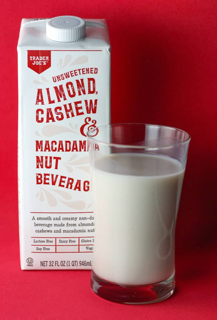 Trader Joe's Unsweetened Almond Cashew and Macadamia Nut Beverage with glass