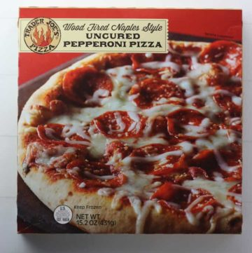 An unopened box of Trader Joe's Wood Fired Naples Style Uncured Pepperoni Pizza box