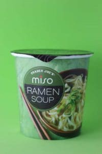 An unopened package of Trader Joe's Miso Ramen Soup on a green background