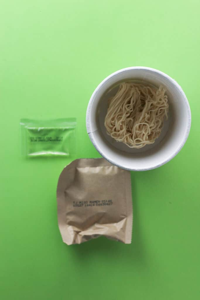 Trader Joe's Miso Ramen Soup revealing the dry noodles, oil packet, and flavor packet