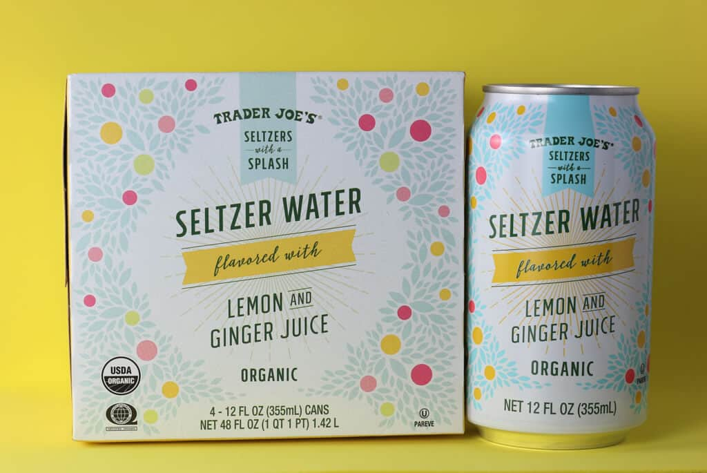 Trader Joe's Seltzer Water flavored with Lemon and Ginger Juice can next to the original box