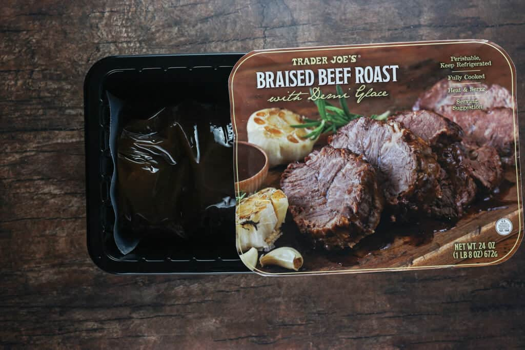 Trader Joe's Braised Beef Roast with Demi Glace with the box open showing the plastic package on the inside