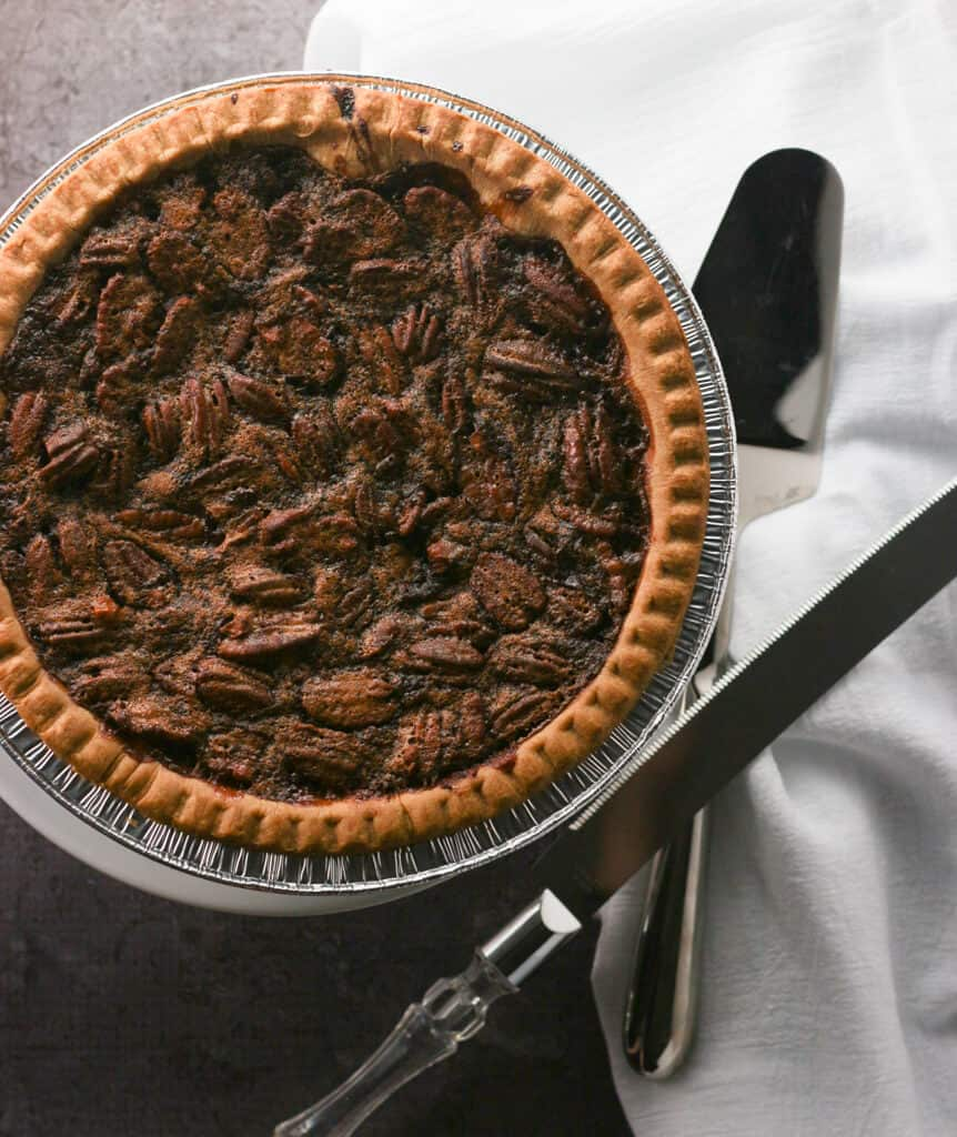 An overhead shot of a chocolate pecan pie made with Trader Joe's Gluten Free Pie Crust