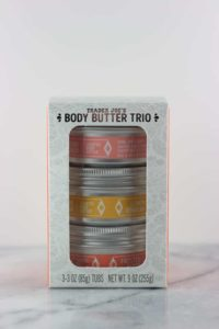An unopened package of Trader Joe's Body Butter Trio