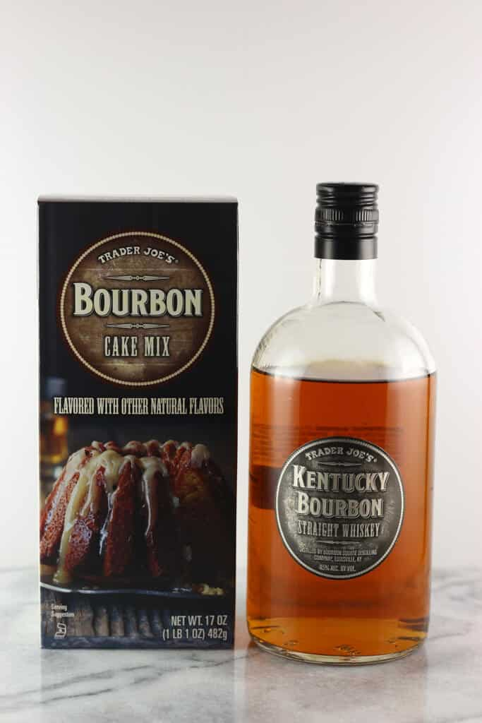 Trader Joe's Bourbon Cake Mix box next to Trader Joe's Kentucky Bourbon