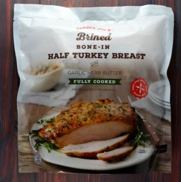 An unopened bag of Trader Joe's Brined Bone In Half Turkey Breast
