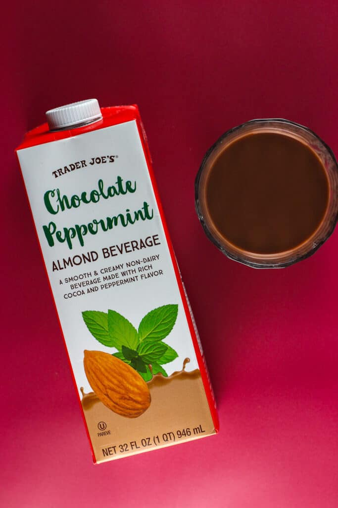 Trader Joe's Chocolate Peppermint Almond Beverage in a cup on a red background