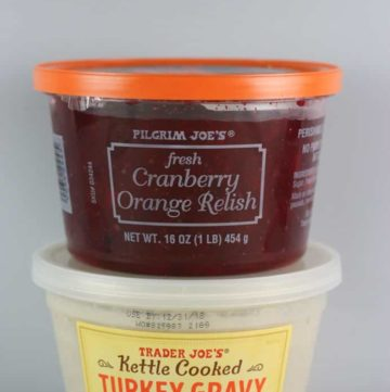 Unopened containers of Trader Joe's Fresh Cranberry Orange Relish and Kettle Cooked Turkey Gravy