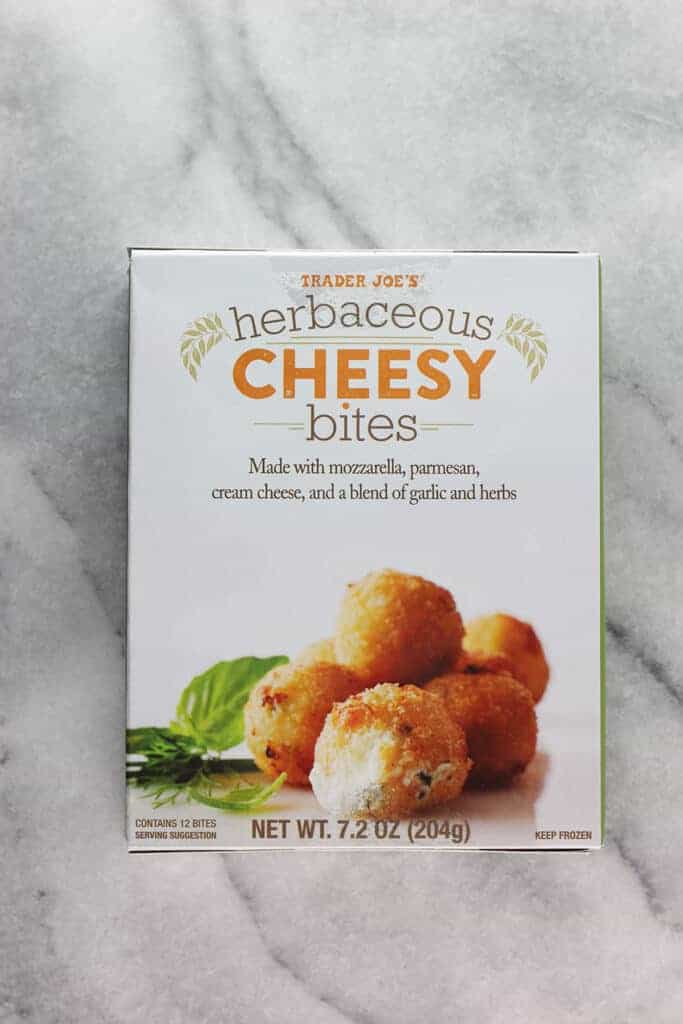 An unopened box of Trader Joe's Herbaceous Cheesy Bites