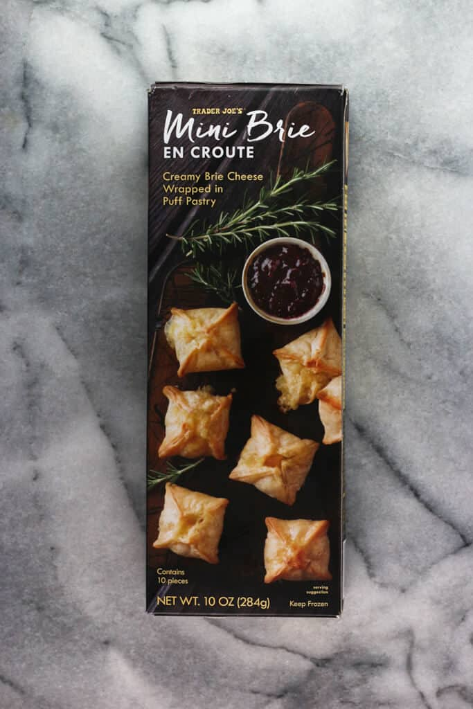 An unopened box of Trader Joe's Mini Brie en Croute