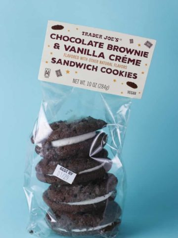 An unopened bag of Trader Joe's Chocolate Brownie and Vanilla Creme Sandwich Cookies