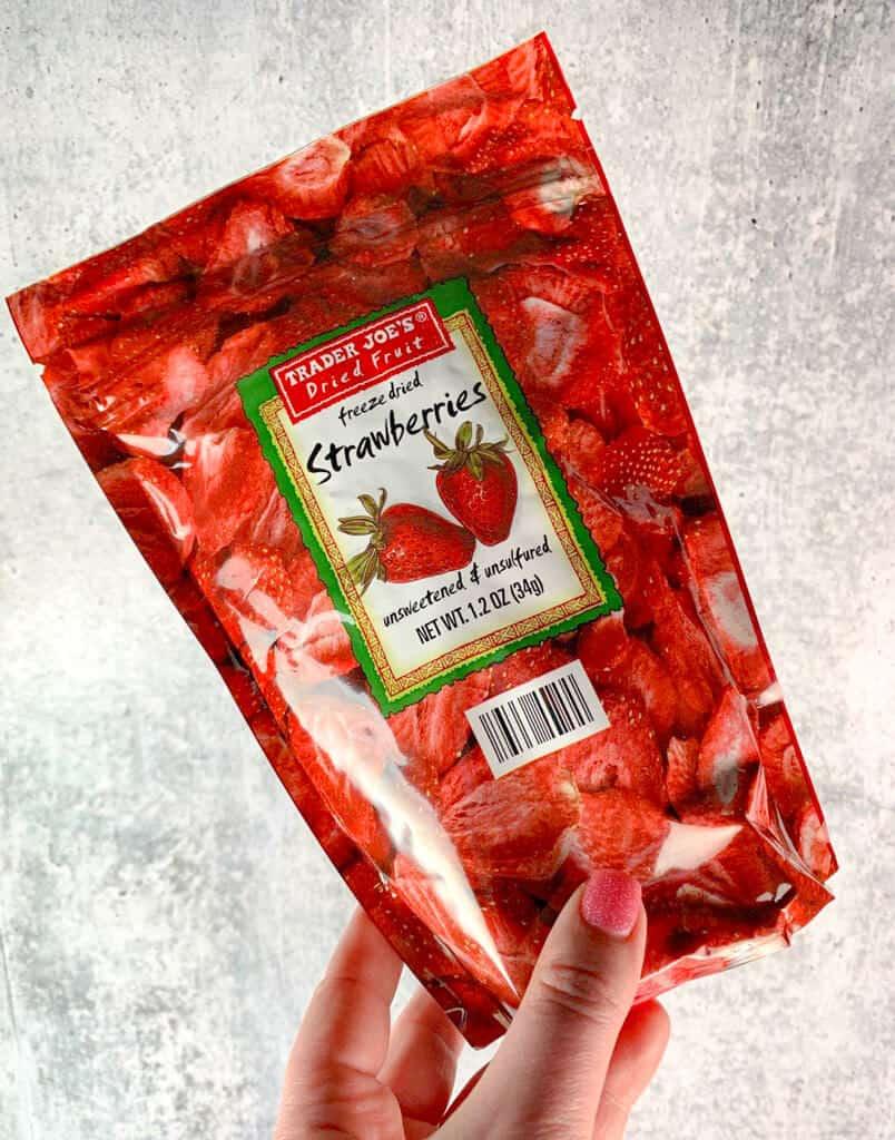 Trader Joe's Freeze Dried Strawberries held up against a grey background