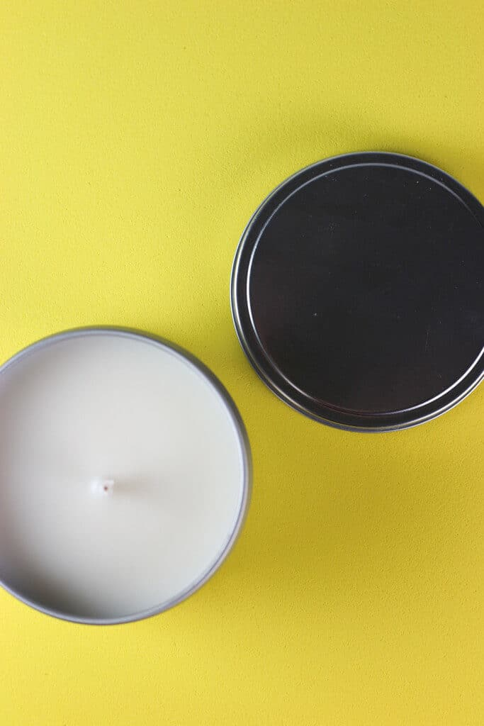 An open Trader Joe's Lemon Cookie Scented Candle showing the unburned wick