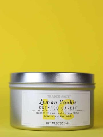 Trader Joe's Lemon Cookie Scented Candle on a yellow background