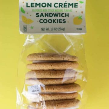 An unopened bag of Trader Joe's Lemon Creme Sandwich Cookies on a yellow background