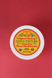An unopened container of Trader Joe's Organic Creamy Cashew Fiesta Dip