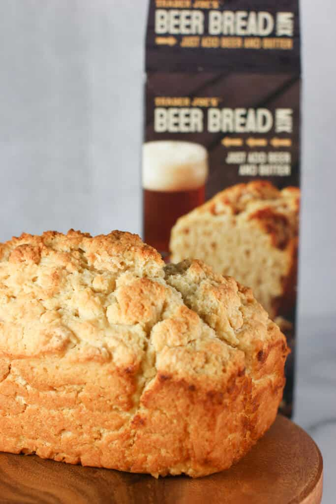 Trader Joe's Beer Bread Mix fully cooked with the empty box in the background