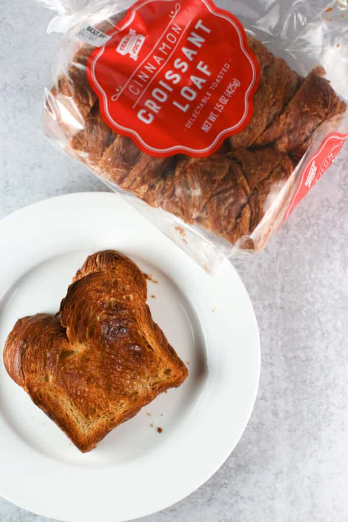 Trader Joe's Cinnamon Croissant Loaf toasted, buttered and on a plate