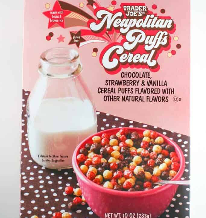 An unopened box of Trader Joe's Neapolitan Puffs Cereal