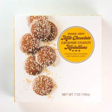 An unopened box of Trader Joe's Milk Chocolate Caramel Crunch Medallions