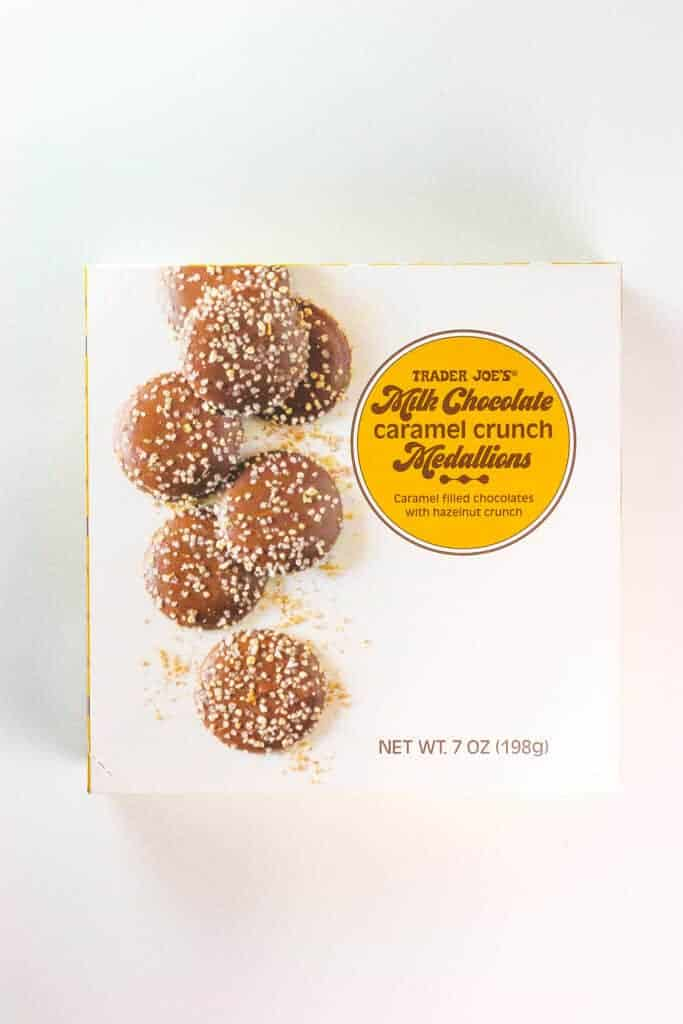 An unopened box of Trader Joe's Milk Chocolate Caramel Crunch Medallions