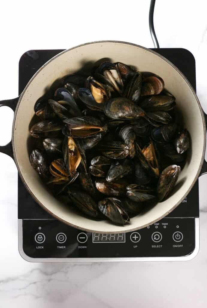Step 5 of making Mussels in White Wine Sauce showing the open mussels