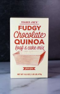An unopened box of Trader Joe's Fudgy Chocolate Quinoa Loaf and Cake Mix