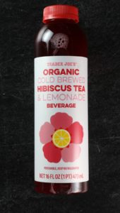 An unopened container of Trader Joe's Organic Cold Brewed Hibiscus Tea and Lemonade