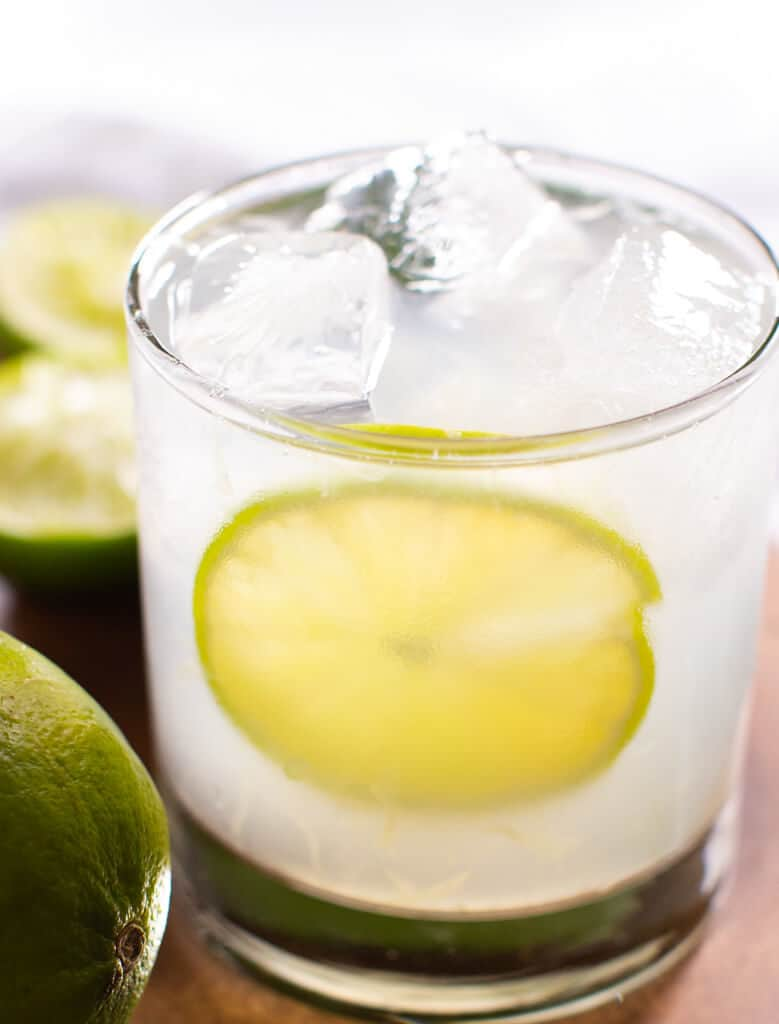 A vodka gimlet served in a rocks glass and filled with ice