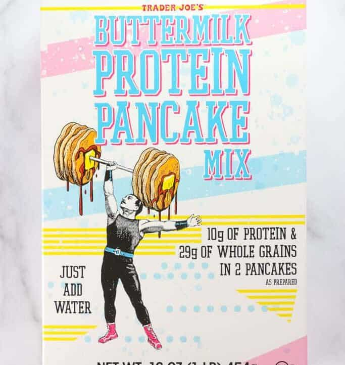An unopened box of Trader Joe's Buttermilk Protein Pancake Mix on a marble surface