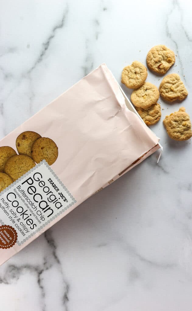 An open bag of Trader Joe's Georgia Pecan Butterscotch Chip Cookies with six cookies peaking out