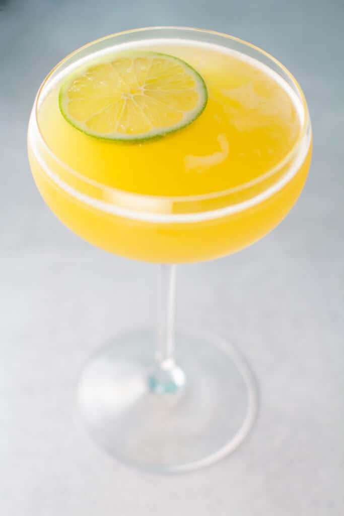 A finished Matador Cocktail garnished with a lime wedge