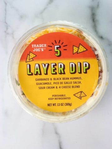 An unopened package of Trader Joe's 5 Layer Dip