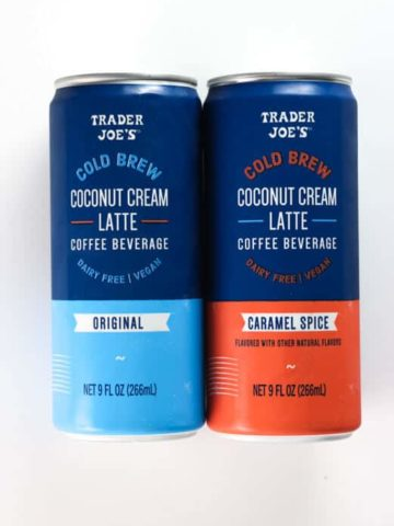 Two unopened cans of Trader Joe's Cold Brew Coconut Cream Latte. One plain and one caramel