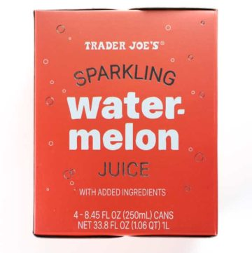 An unopened box of Trader Joe's Sparkling Watermelon Juice on a white surface