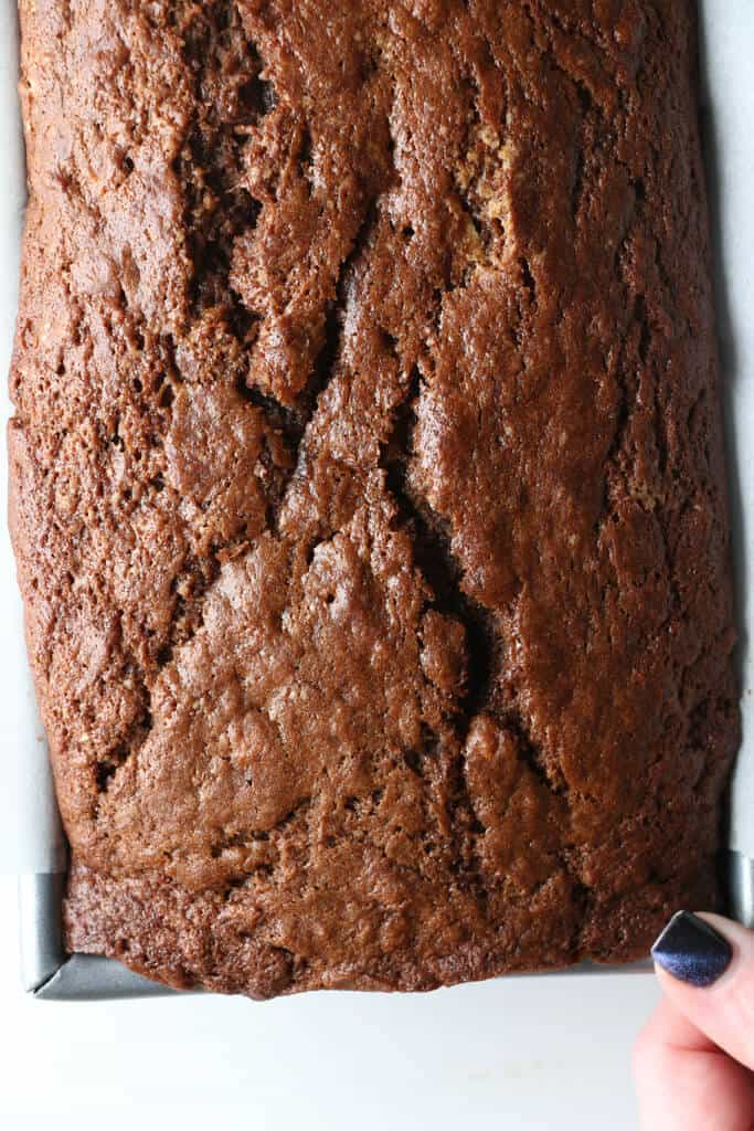 A view of chocolate banana bread coming out of the oven. A view from the top of the loaf
