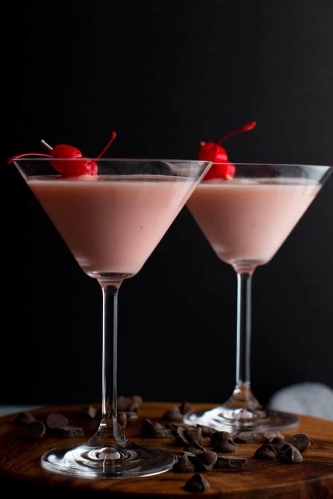 Two finished Pink Squirrels garnished with cherries