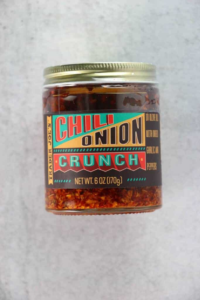 An unopened jar of Trader Joe's Chili Onion Crunch