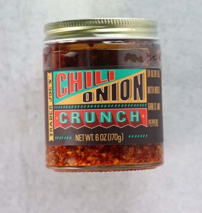 An unopened jar of Trader Joe's Chili Onion Crunch