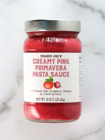An unopened jar of Trader Joe's Creamy Pink Primavera Pasta Sauce