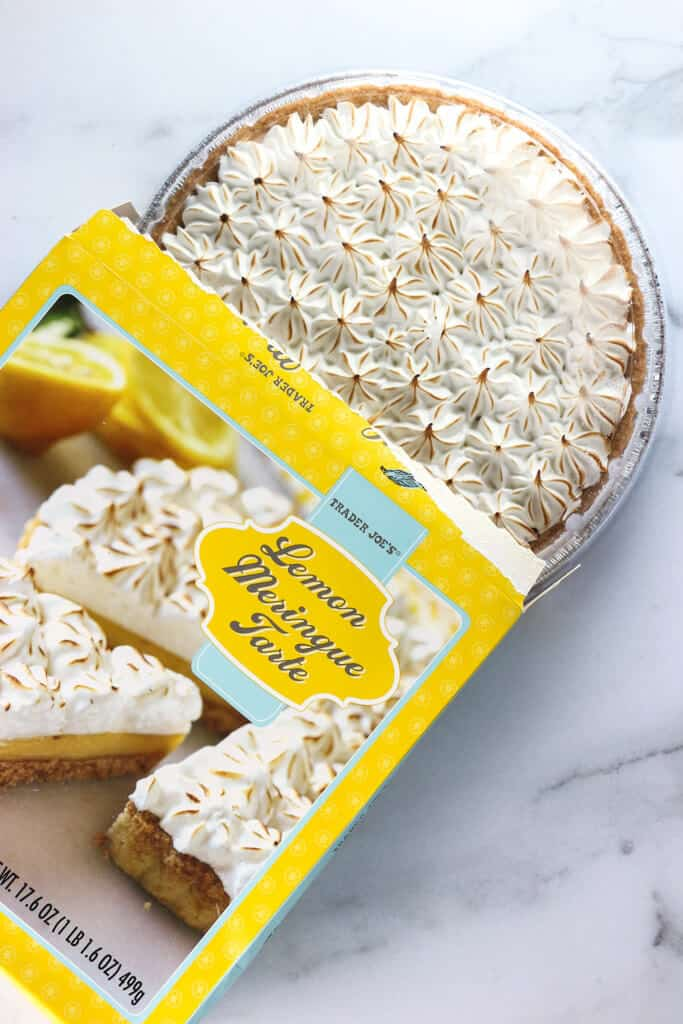 A defrosted Trader Joe's Lemon Meringue Tarte on a marble surface