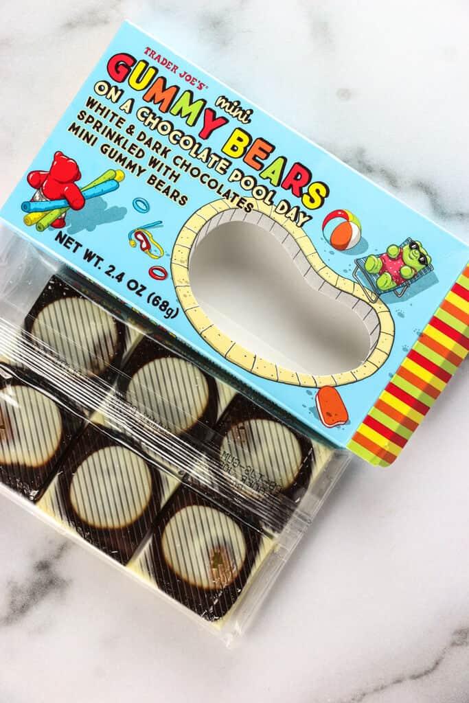 An opened box of Trader Joe's Mini Gummy Bears on a Chocolate Pool Day revealing the dark chocolate