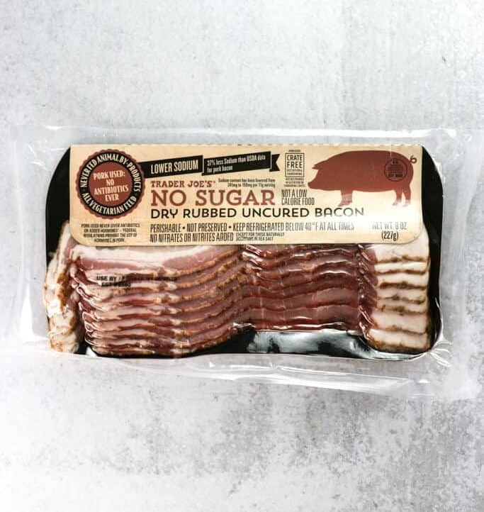 An unopened package of Trader Joe's No Sugar Dry Rubbed Uncured Bacon