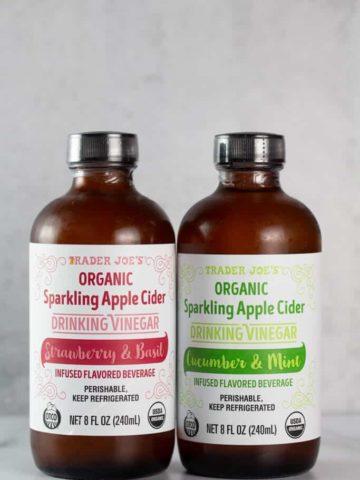 Two unopened bottles of Trader Joe's Organic Sparkling Apple Cider Drinking Vinegar