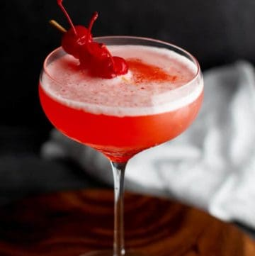 A finished Mary Pickford cocktail garnished with some cherries