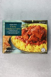 An unopened box of Trader Joe's Fiery Chicken Curry