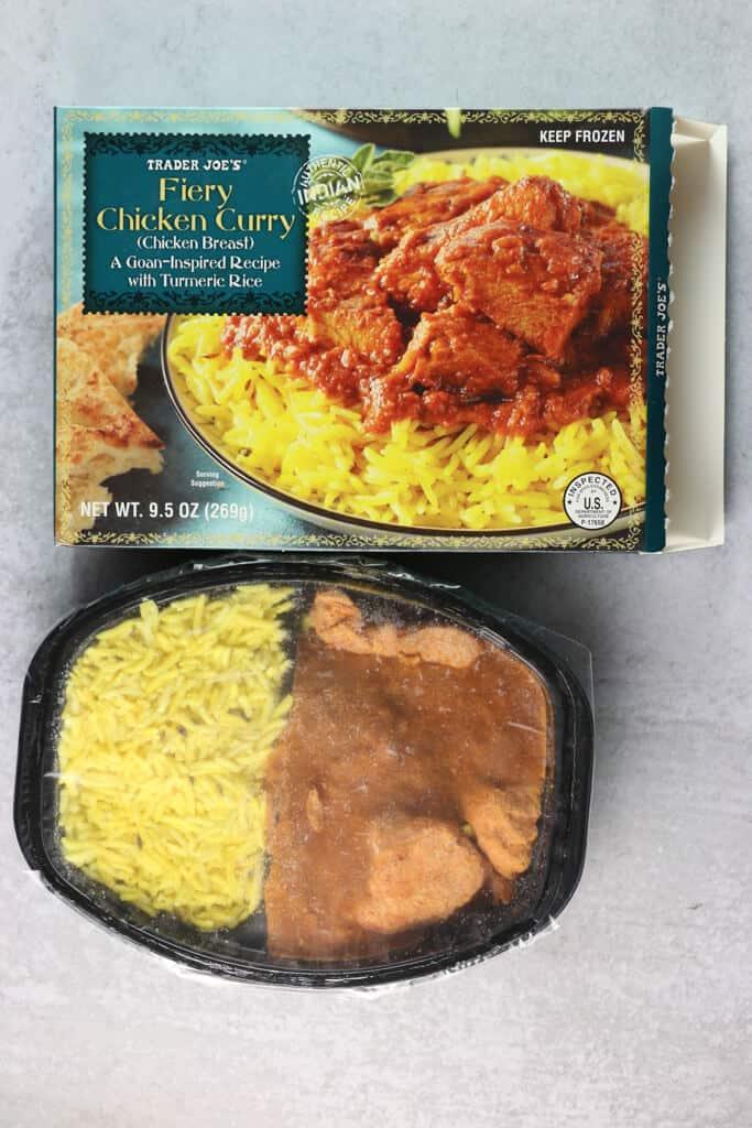 A frozen Trader Joe's Fiery Chicken Curry next to the original box