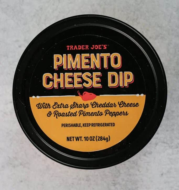 An unopened container of Trader Joe's Pimento Cheese Dip