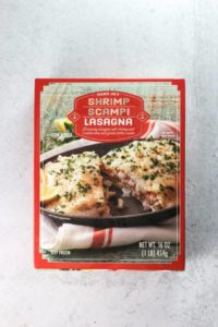 An unopened box of Trader Joe's Shrimp Scampi Lasagna